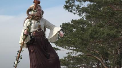 Female Druid talking