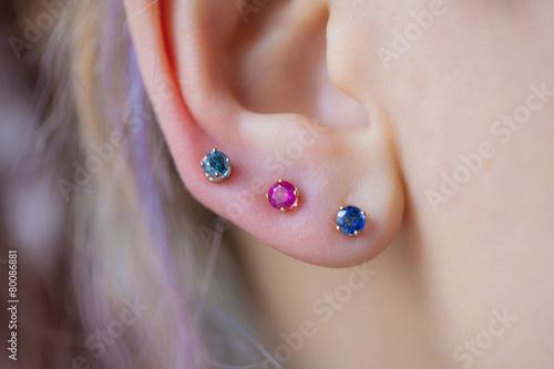 Woman's ear wearing a beautiful earrings - 80086881