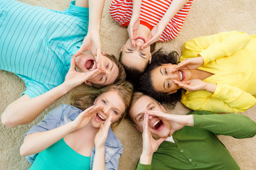smiling people lying down on floor and screaming
