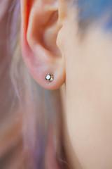 Woman's ear wearing a beautiful earring