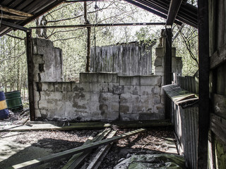 Abandoned ramshackle shack with torn down brick stone wall