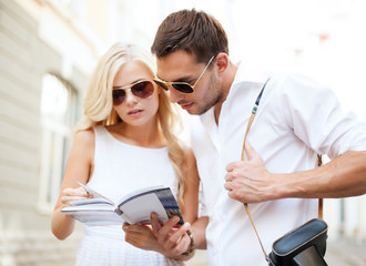 couple with tourist book in the city