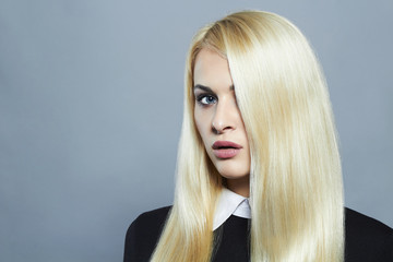 Young blond woman with healthy hair.Beautiful schoolgirl