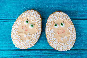 Two lambs. Easter cookie on blue wooden background