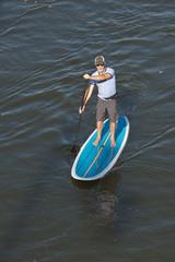 man paddleboarding, overhead shot