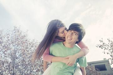 Happy teenage couple outdoors