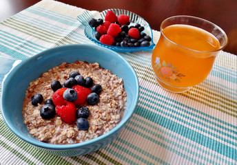 A bowl of oatmeal topped with fresh fruit