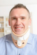 Man in cervical collar