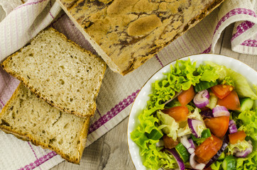 Handmade bread with vegetables salad