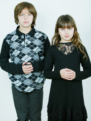 Girl and boy dressed in black