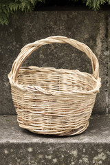 Wicker basket on a stone bench