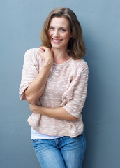 Cheerful mid adult woman smiling in jeans and sweater