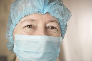 Smiling female doctor in hospital hallway