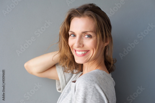 Happy smiling beautiful woman posing with hand - 80096681