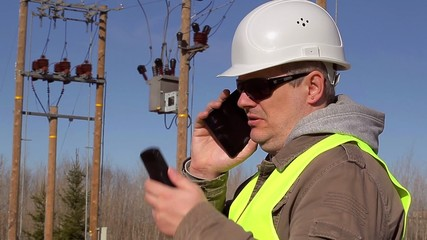 Electrical engineer talking on cell phone at outdoors