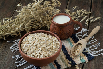 Oatmeal, milk and stalks of oats