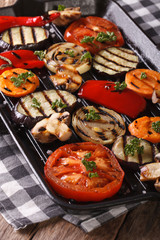 Vegetables cooked on the grill pan closeup. vertical