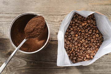 coffee beans and ground coffee on wooden background