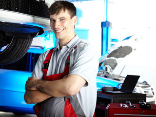 Motor mechanic is satisfied with his job