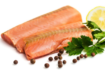 Raw salmon fillet with lemon, black pepper and parsley