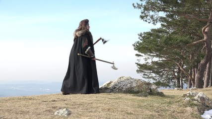 Female nordic warrior drawing axe