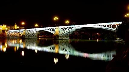 Guadalquivir river in Seville at Night 4K