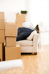 Moving: Anonymous Man Resting On Couch After Packing