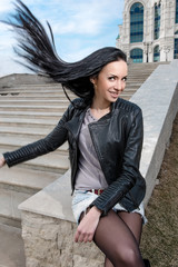 Outdoor  beautiful young girl with flying long dark hair