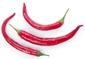 Red peppers on a white background.