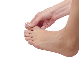 massaging her toe