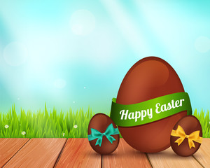 Vector easter chocolate eggs on rustic wooden planks and grass