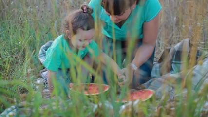 girls cut watermelon