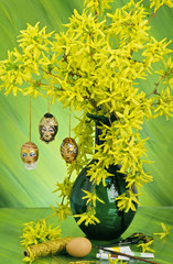 Hand-made painted eggs hanging on yellow bunch