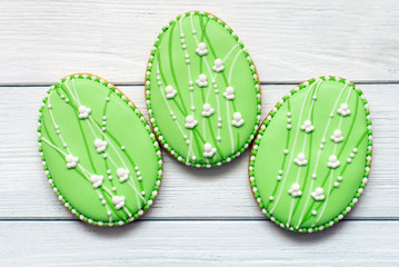 Three Big Easter cookies on a grey background