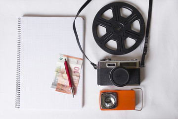Overhead shot of a photographers workspace. A vintage film camer