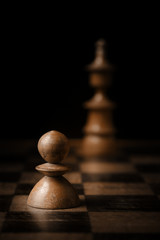 Chess. White pawn and king on chessboard.