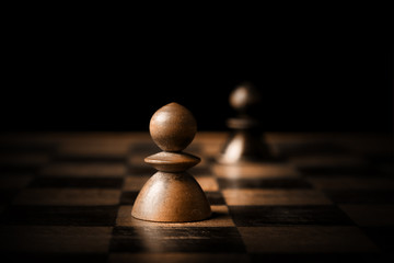 Chess. White and black pawn on chessboard.