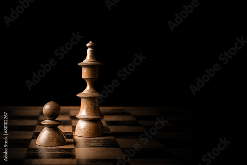 Chess. White pawn and king on chessboard. - 80102267