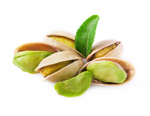 Pistachio with leaves isolated on white.