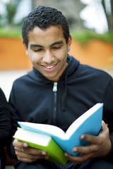 Happy african american teenager reading