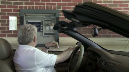 Man can't get money from a drive-up ATM.  Life appears and gives him a lemon. Jib-mounted camera.