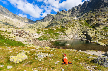 Woman tourist laying on grass in Tatra Mountains, Slovakia