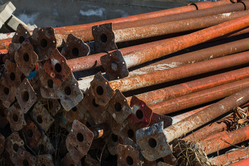 old scaffold tubes storaged outside in a pile