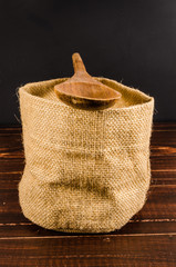 empty sack bag on wooden table,blank burlap bag with wooden spoo