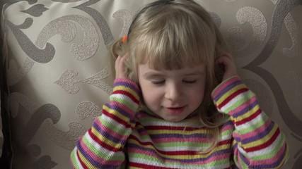 Little Girl in Headphones Listening to Music.Moving. Head shake.
