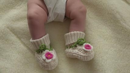 Baby Moves by Feet in Funny Socks. 4k Ultra HD