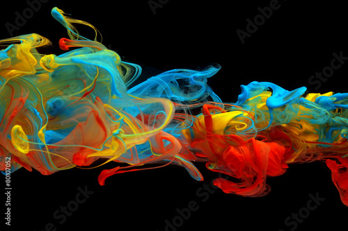 Colorful ink swirling through water - 80107052