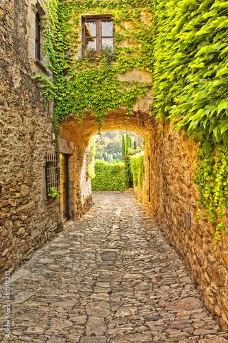 Typical street in Peratallada, Catalonia, Spain - 80107231
