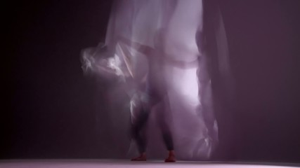 Gymnastic young woman dances with silks.  Montage clip created with long shutter speed and various effects to create almost a painted animation feel.  Looping clip.
