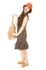 Smiling Asian American teen girl holding a brown purse wearing p